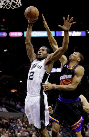 San Antonio Spurs' Kawhi Leonard (2) drives to the basket as Phoenix Suns' Wesley Johnson, right, defends during the first half of an NBA basketball game, Wednesday, Feb. 27, 2013, in San Antonio. Photo: Eric Gay, Associated Press / AP