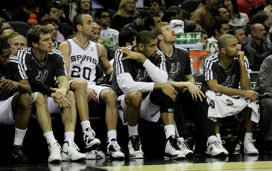 Spurs' Kawhi Leonard (02), Tiago Splitter (22), Manu Ginobili (20), Tim Duncan (21), Matt Bonner (15) and Tony Parker (09) watch the game from the bench in the first quarter against the Phoenix Suns at the AT&T Center on Wednesday, Feb. 27, 2013. Photo: Kin Man Hui, San Antonio Express-News / © 2012 San Antonio Express-News