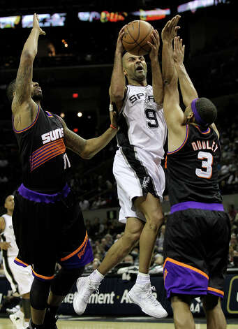 Spurs' Tony Parker (09) gets defended in the paint by Phoenix Suns' Markieff Morris (11) and Jared Dudley (03) in the second half at the AT&T Center on Wednesday, Feb. 27, 2013. Suns defeated the Spurs, 105-101. Photo: Kin Man Hui, San Antonio Express-News / © 2012 San Antonio Express-News
