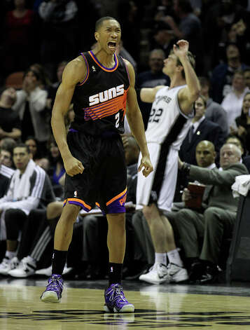 Phoenix Suns' Wesley Johnson (02) reacts after hitting a three over Spurs' Tiago Splitter (22) to take the game into overtime at the AT&T Center on Wednesday, Feb. 27, 2013. Suns defeated the Spurs, 105-101. Photo: Kin Man Hui, San Antonio Express-News / © 2012 San Antonio Express-News
