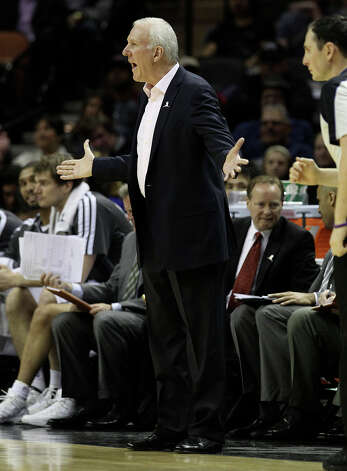 Spurs coach Gregg Popovich calls out to his players on the floor during their game against the Phoenix Suns in the second half at the AT&T Center on Wednesday, Feb. 27, 2013. Suns defeated the Spurs, 105-101. Photo: Kin Man Hui, San Antonio Express-News / © 2012 San Antonio Express-News