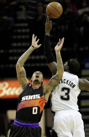 Spurs' Stephen Jackson (03) gets the upper hand on a rebound against Phoenix Suns' Michael Beasley (00) in the first half at the AT&T Center on Wednesday, Feb. 27, 2013. Photo: Kin Man Hui, San Antonio Express-News / © 2012 San Antonio Express-News