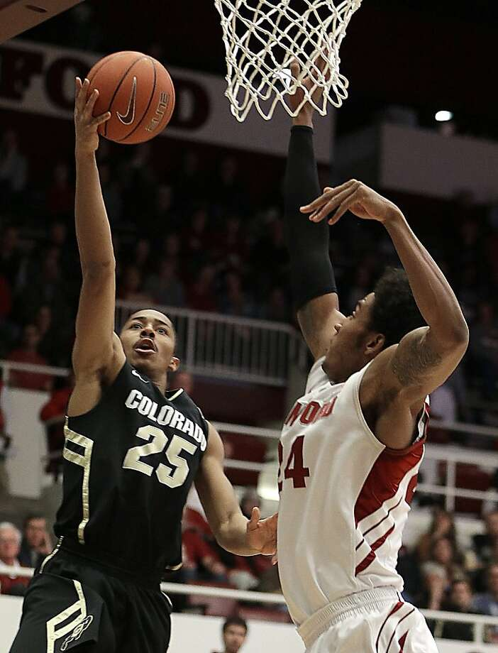Spencer Dinwiddie, who had 19 points, shoots against Stanford's Josh Huestis in the first half. Photo: Ben Margot, Associated Press