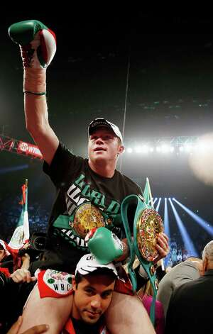 Canelo Alvarez, of Mexico, celebrates defeating Josesito Lopez following their super welterweight championship boxing match on Saturday, Sept. 15, 2012, in Las Vegas. Photo: Isaac Brekken, Associated Press / FR159466 AP