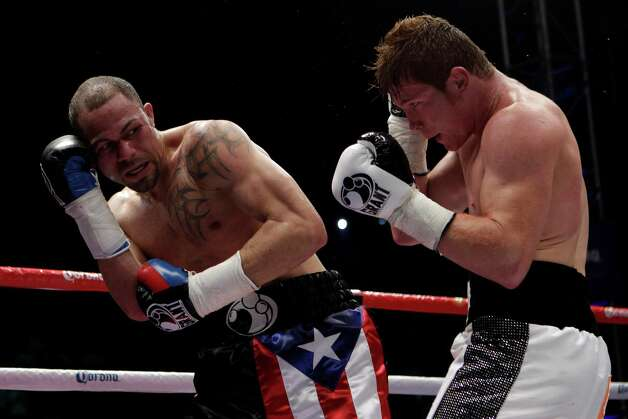 "Saul ""Canelo"" Alvarez, of Mexico, right, fights Kermit Cintron, from Puerto Rico, during a WBC light middleweight championship boxing bout in Mexico City,  Saturday, Nov. 26, 2011. Photo: Dario Lopez-Mills, Associated Press / AP"