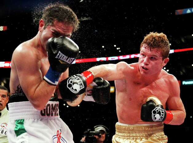 Canelo Alvarez, right, of Mexico, lands a punch against Alfonso Gomez, of Mexico, during the fifth round of their WBC super welterweight title boxing match, Saturday, September 17, 2011, in Los Angeles. Alvarez won by TKO as the referee stopped the fight in the sixth round. (AP Photo/Danny Moloshok) Photo: Danny Moloshok, Associated Press / FR161655 AP