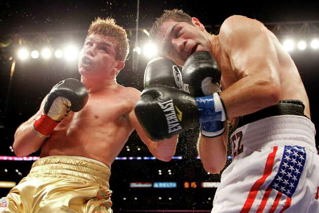 Canelo Alvarez, left, of Mexico, lands a punch against Alfonso Gomez, right, of Mexico, during the fourth round of their WBC super welterweight title boxing bout, Saturday, Sept.  17, 2011, in Los Angeles. Alvarez won by TKO as the referee stopped the fight in the sixth round. Photo: Danny Moloshok, Associated Press / FR161655 AP