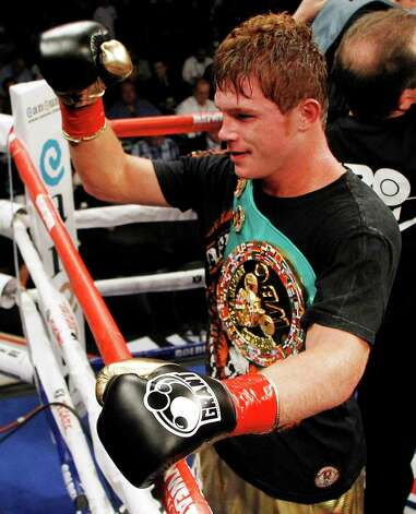 Canelo Alvarez, of Mexico, celebrates his TKO victory after the referee stopped the fight in the sixth round against Alfonso Gomez, also of Mexico, during their WBC super welterweight title boxing bout on Saturday, Sept. 17, 2011, in Los Angeles. Photo: Danny Moloshok, Associated Press / FR161655 AP