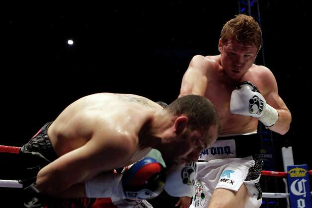 "Saul ""Canelo"" Alvarez, of Mexico, right, hits Kermit Cintron, from Puerto Rico, during a WBC light middleweight championship boxing bout in Mexico City, Saturday, Nov. 26, 2011. Photo: Dario Lopez-Mills, Associated Press / AP"