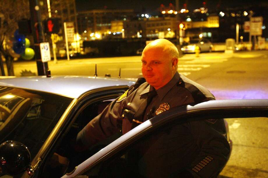 Seattle Police DUI Squad member Eric Michl, shown here in Dec. 2009, worked with defense attorney Megan Giske to find the home for a German Shepard that had belonged to a man he arrested.