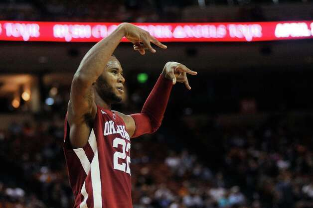 "Oklahoma's Amath M'Baye signals ""horns down"" to the Texas crowd after a dunk in the second half of an NCAA basketball game in Austin, Texas on Feb. 27, 2013.  (AP Photo/The Daily Texan, Lawrence Peart) Photo: Laura Skelding, Statesman.com / The Daily Texan"