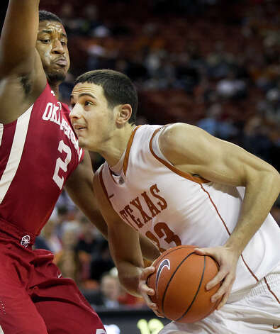 Texas'  Ioannis Papapetrou (33) drives against Oklahoma's Steven Pledger (2) during an NCAA college basketball game on Wednesday, Feb. 27, 2013, in Austin, Texas. Photo: Laura Skelding, Statesman.com / Austin American-Statesman