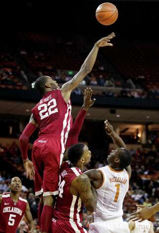 Oklahoma's Amath M'Baye (22) and Romero Osby (24) battle for a loose ball with Texas' Sheldon McClellan (1) during an NCAA college basketball game on Wednesday, Feb. 27, 2013, in Austin, Texas. Photo: Laura Skelding, Statesman.com / Austin American-Statesman