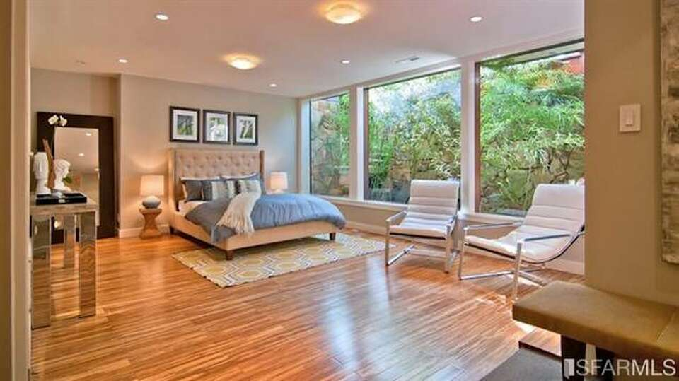 Even more woodsy bedroom. All photos via Sotheby's/Estately.