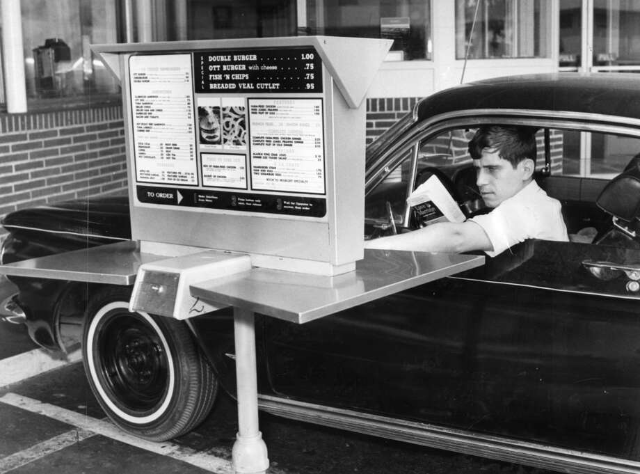 Aug. 7, 1967: Abraham Durham orders at Ott's Drive-in, the first diner in the city to use an automated drive-through. Drivers were confused, and waitresses had to come out and explain the contraption.