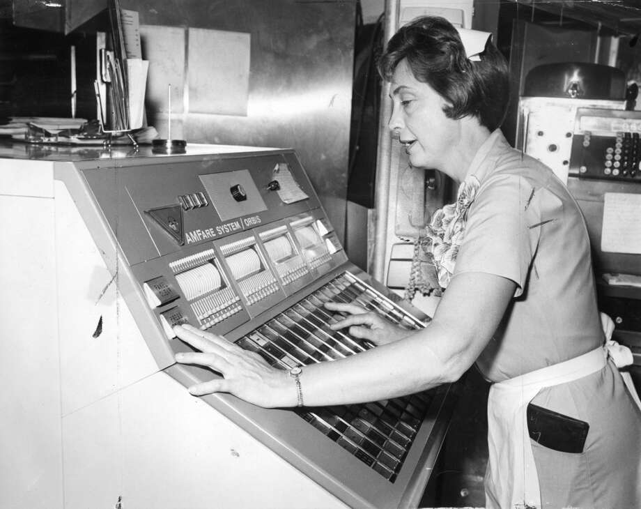 Betty Kunkel works the refrigerator-sized computer at Ott's Drive-in. It was basically a giant version of the current McDonald's cash register, with words like Burger and Chocolate milkshake on large buttons.