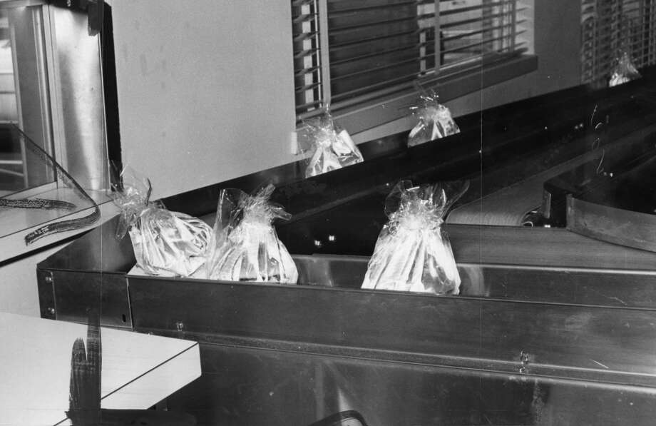 Hamburgers on a conveyor belt. SF's first drive-through was even more automated than today's fast food. The burgers and buns were cooked by machine and most of the assembly was automatic.