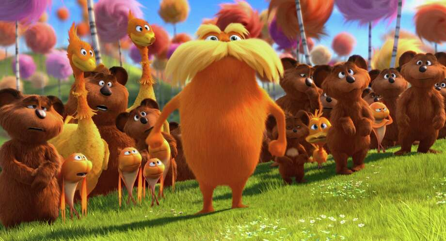 "FILE - In this film image released by Universal Pictures, animated character Lorax, voiced by Danny Devito, center, stands with  stands with the Bar-ba-loots, Swomee-Swans and Humming-Fish in a scene from ""Dr. Seuss' The Lorax."" A Monterey Cypress tree believed to have inspired Dr. Seuss' famous children's book The Lorax fell last week. The tree's curved trunk and mass of leaves are believed to have inspired the Truffula trees from The Lorax, a fable about environmental destruction that was published in 1971. Photo: Universal Pictures, Associated Press / © 2012 Universal Pictures"