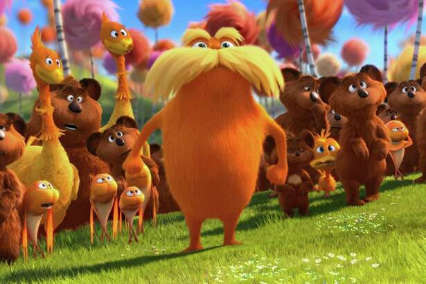 "In this film image released by Universal Pictures, animated character Lorax, voiced by Danny Devito, center, stands with stands with the Bar-ba-loots, Swomee-Swans and Humming-Fish in a scene from ""Dr. Seuss' The Lorax."" (AP Photo/Universal Pictures)"