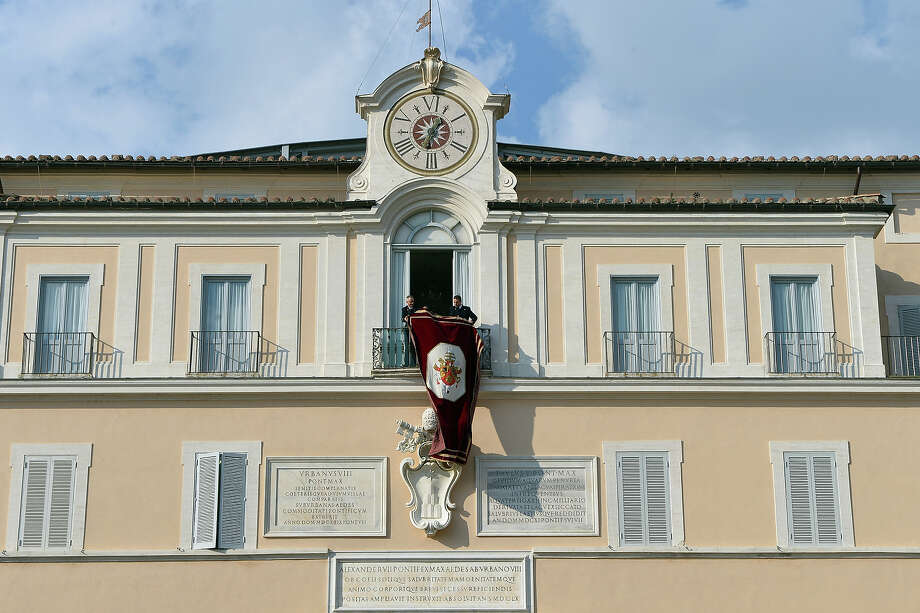 Assistants prepare the balcony where Pope-emeritus Benedict XVI will salute faithful upon his arrival on February 28, 2013 in Castel Gandolfo. Photo: VINCENZO PINTO, AFP/Getty Images / 2013 AFP