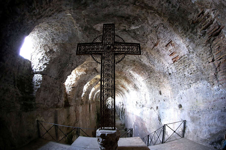 A cross stands in the Roman catacombs in the gardens of the Pontifical residence of Castelgandolfo o