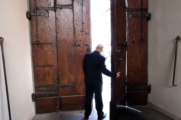 A man opens the main door of the Apostolic Palace of Castelgandolfo on February 20, 2013 in Rome. Photo: Franco Origlia, Getty Images / 2013 Getty Images