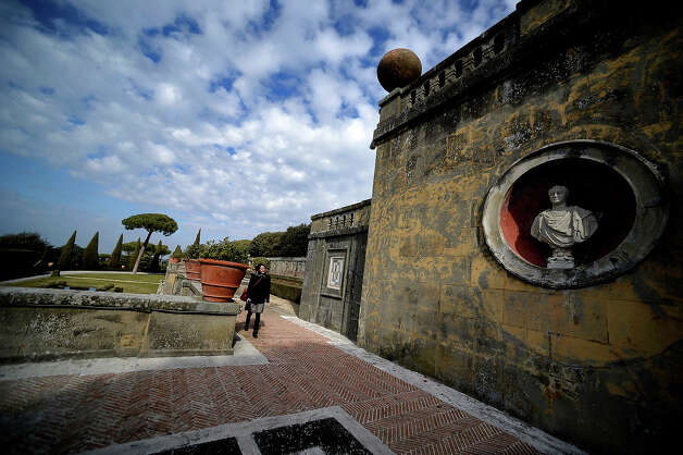 A visitor walks on February 20, 2013 in the gardens of the Apostolic Palace of Castel Gandolfo. Photo: FILIPPO MONTEFORTE, AFP/Getty Images / 2013 AFP