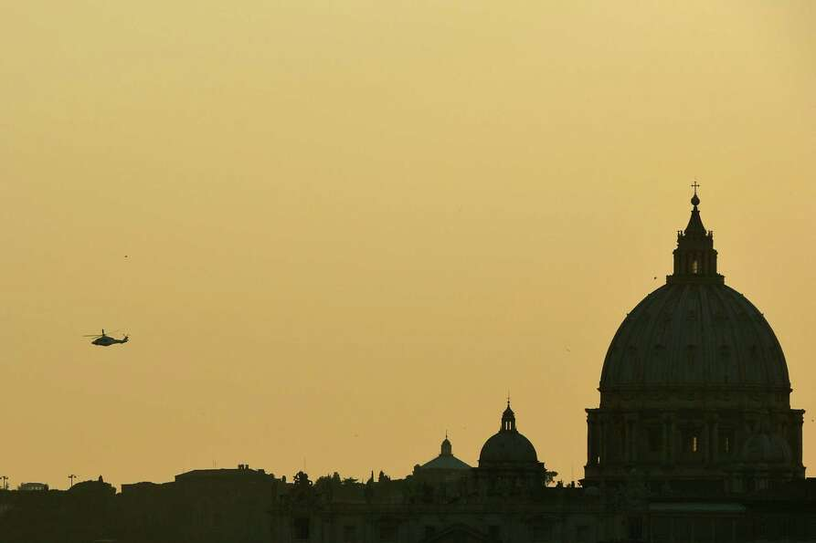 The helicopter with Pope Benedict XVI aboard flies over St Peter's 