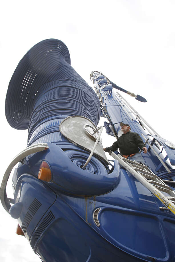 "Artist Bob Wade's 70-foot ""Smokesax"" is moving Thursday from its 20-year home at 6025 Richmond, near Houston's Galleria area. The Orange Show Center for Visionary Art acquired the giant blue saxophone. Photo: ."