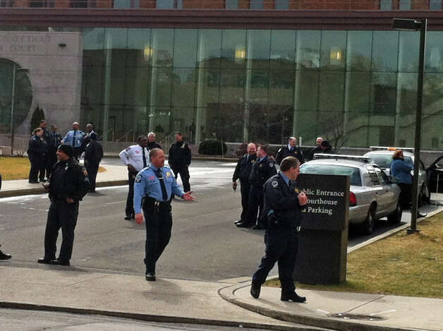Judicial marshals and Stamford police clear state Superior Court in Stamford following a bomb threat on Thursday, Feb. 28, 2013. Photo: Lindsay Perry