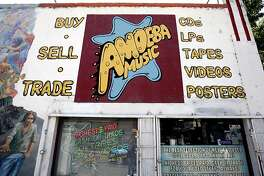 {filename SHOWN:  Amoeba Music at 2455 Telegraph Ave.  Telegraph Ave. in Berkeley, CA. (Katy Raddatz/The Chronicle) ** Ran on: 07-19-2007 Telegraph, top left, is popular with teens and UC students. Amoeba Music, top right, sells new and used music. Stephen Riedel, right, shows a shirt to Yolanda Trevino.