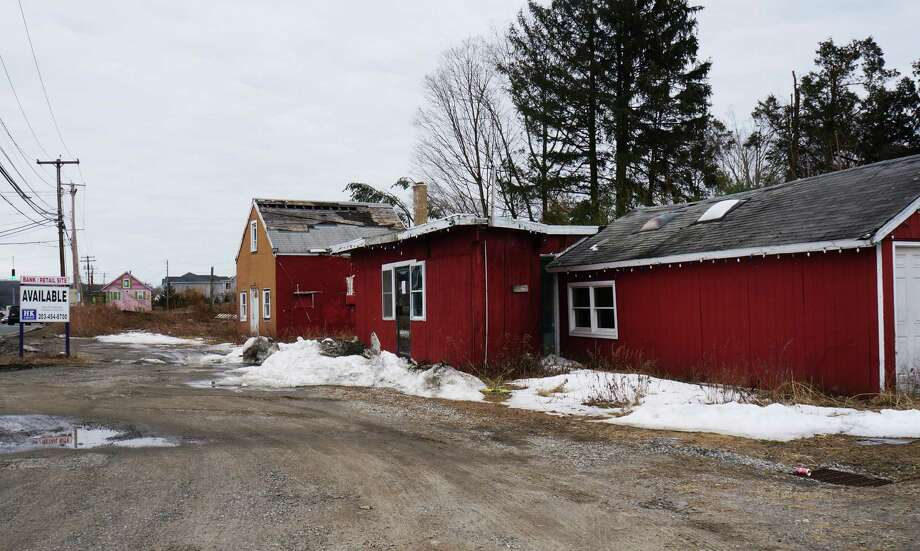 The Representative Town Meeting received a report on blighted buildings in town, including this one at 3611 Post Road. Photo: Genevieve Reilly / Fairfield Citizen