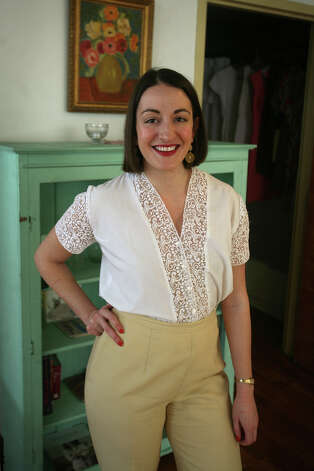 Faith Fennelly, of Bridgeport, models one of the many vintage outfits that she has purchased. Fennelly said she acquired her passion for vintage clothes while living in London. Photo: Brian A. Pounds / Connecticut Post