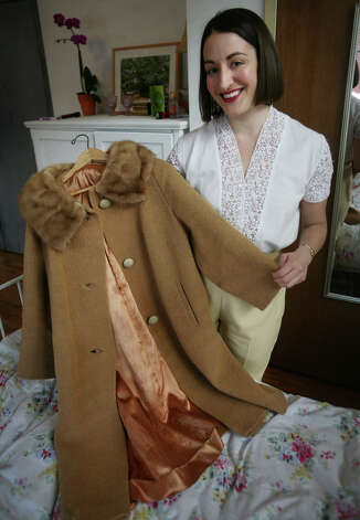 Faith Fennelly, of Bridgeport, shows off a vintage coat that she purchased while living in London. Fennelly said she is still discovering local shops that sell vintage items. Photo: Brian A. Pounds / Connecticut Post