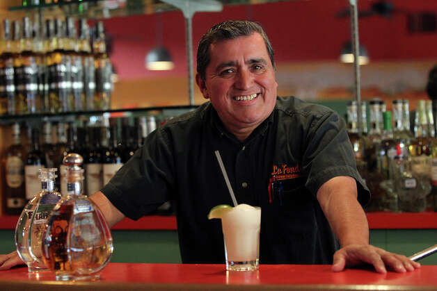 Juan Romero makes his famous margarita at La Fonda restaurant on February 27, 2013. Photo: TOM REEL