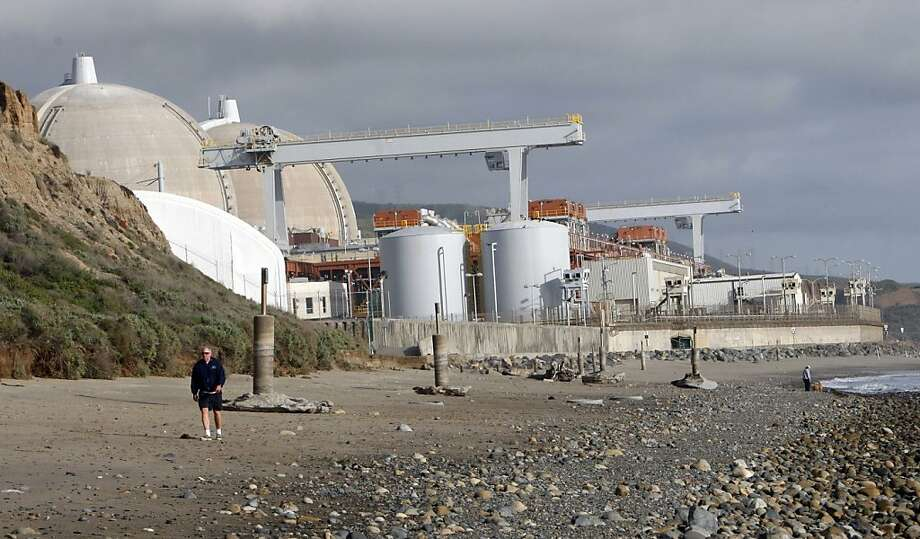 "FILE - In this March 1, 2010 file photo, the San Onofre nuclear power plant, seen here in north San Diego County, Calif. Looming federal spending cuts are expected to dampen California's economic recovery at a time when a housing rebound and job growth are gaining traction, but come Friday the immediate effect may not prove to be the fiscal doomsday that President Barack Obama has predicted. The White House estimates that in California, 64,000 civilian defense workers would be furloughed and 1,200 teaching and teacher aide jobs would be put at risk from the mandatory budget reductions known as the ""sequester."" Obama administration officials also said the state will see program cuts in children's vaccines, senior nutrition, student work-study jobs and assistance for victims of domestic violence. (AP Photo/Lenny Ignelzi, file) Photo: Lenny Ignelzi, Associated Press"