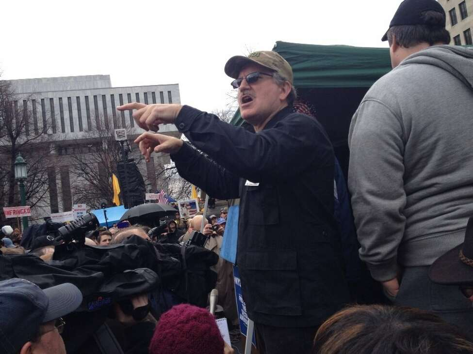 A sign language interpreter in hunter's camouflage at a Second Amendment rally at the Capitol in Albany on Thursday, Feb. 28, 2013. (Jimmy Vielkind/Times Union)