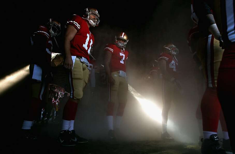 Quarterbacks Alex Smith (11) and Colin Kaepernick (7) of the San Francisco 49ers  prepare to take th