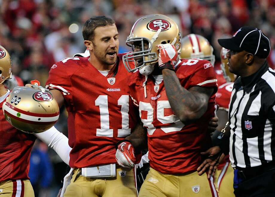Vernon Davis (85) of the San Francisco 49ers reacts with Alex Smith #11 after his touchdown in the fourth quarter of the NFC Divisional playoff game against the New Orleans Saints at Candlestick Park on January 14, 2012 in San Francisco, California. Photo: Thearon W. Henderson, Getty Images