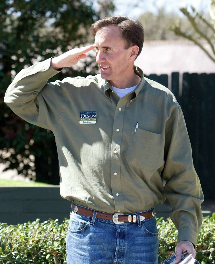 Congressional District 22 candidate Pete Olson, who was in the Navy, salutes as they arrive to vote at the Sugar Creek Country Club March 4, 2008    in Sugar Land, Texas. Photo: BOB LEVEY, For The Chronicle / Freelance