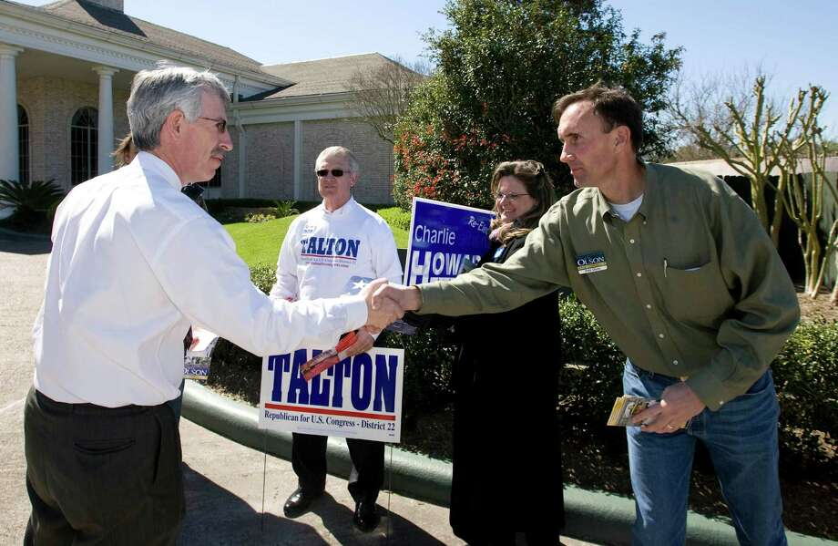 Congressional District 22 candidate Pete Olson, right, greets voters as they arrive to vote at the Sugar Creek Country Club March 4, 2008 in Sugar Land, Texas. Photo: BOB LEVEY, For The Chronicle / Freelance