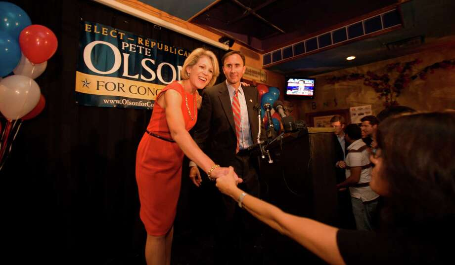 Pete Olson and his wife Nancy Olson talk with supporters after Pete Olson addresses the crowd at his victory party in Sugar Land.  Supporters of Pete Olson, Republican candidate for Congress in Texas' 22nd district gathered at Berryhill Baja Grill in Sugar Land to watch returns and support their candidate.    (Tuesday, Nov. 4, 2008, in Richmond. Photo: Steve Campbell, Houston Chronicle / Houston Chronicle