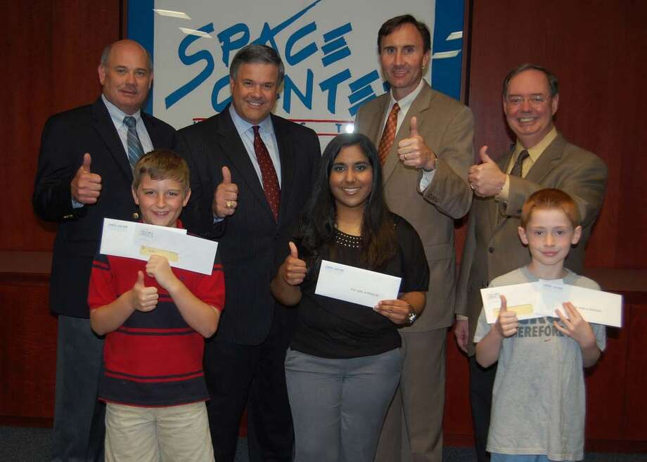 More than a thousand CCISD students participated in a letter writing competition to persuade NASA Administrator Charles Bolden to send one of the three remaining shuttle orbiters to Houston Texas once the fleet is retired later this year. Congressman Pete Olson, Bay Area Houston President, Bob Mitchell, CCISD Superintendent Dr. Greg Smith, and Space Center Houston President and CEO Richard E. Allen, Jr. were on hand at the awards ceremony held on April 7.  Winners in each category received a check for $100 from BAHEP and complimentary tickets for one year to Space Center Houston for their entire family. And the winners are...Jeremy Spendley, 2nd grade, Ward Elementary; Ryan Bevolo, 5th grade, North Pointe Elementary; and Deena Kapadia, 12th grade, Clear Springs High School. Photo: CCISD Photo / handout