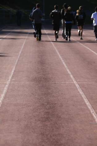 Scuff marks are seen on the running track in different lanes at Kezar Stadium as the Urban School of San Francisco Track team practices on it on Tuesday, February 26, 2013 in San Francisco, Calif. Photo: Lea Suzuki, The Chronicle