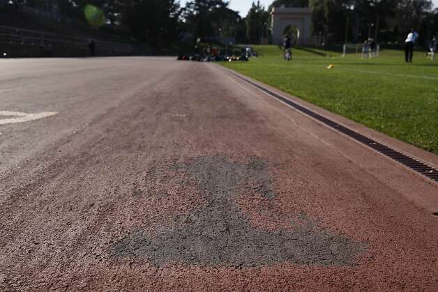 Scuff marks and holes are seen in the running track at Kezar Stadium on Tuesday, February 26, 2013 in San Francisco, Calif. Photo: Lea Suzuki, The Chronicle