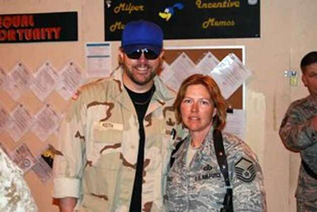 photo of McGee with country star Toby Keith, who performed with the troops in Afghanistan as part of USO tour in April. Courtesy photo Photo: COURTESY PHOTO