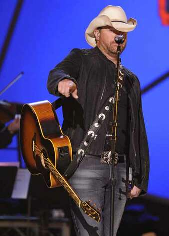 Toby Keith performs Unwound at the ACM Artist of the Decade All Star Concert in honor of George Strait on Monday, April 6, 2009, in Las Vegas. Photo: Mark J. Terrill, AP / AP