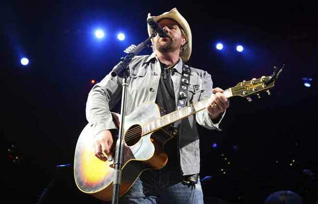 Toby Keith performs during the San Antonio Stock Show & Rodeo Thursday Feb. 18, 2010 at the AT&T Center. PHOTO BY EDWARD A. ORNELAS/eaornelas@express-news.net) Photo: EDWARD A. ORNELAS, SAN ANTONIO EXPRESS-NEWS / eaornelas@express-news.net
