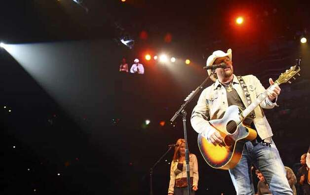 FOR METRO - Toby Keith performs during the San Antonio Stock Show & Rodeo Thursday Feb. 18, 2010 at the AT&T Center. PHOTO BY EDWARD A. ORNELAS/eaornelas@express-news.net) Photo: EDWARD A. ORNELAS, SAN ANTONIO EXPRESS-NEWS / eaornelas@express-news.net