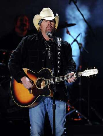 Musician Toby Keith performs onstage during the American Country Awards 2010 held at the MGM Grand Garden Arena on December 6, 2010 in Las Vegas, Nevada. Photo: Kevin Winter, Getty Images / 2010 Getty Images